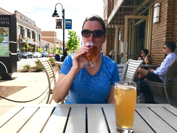 Marnay outside drinking refreshing local beers at Downtown Crown Wine and Beer