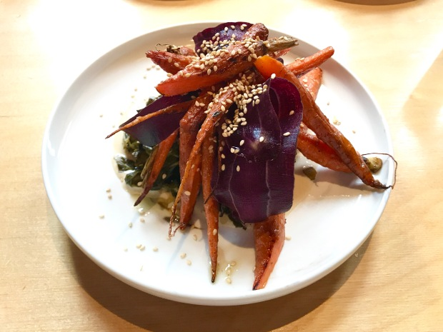 JuneBaby moked carrots topped with nutty benne seeds