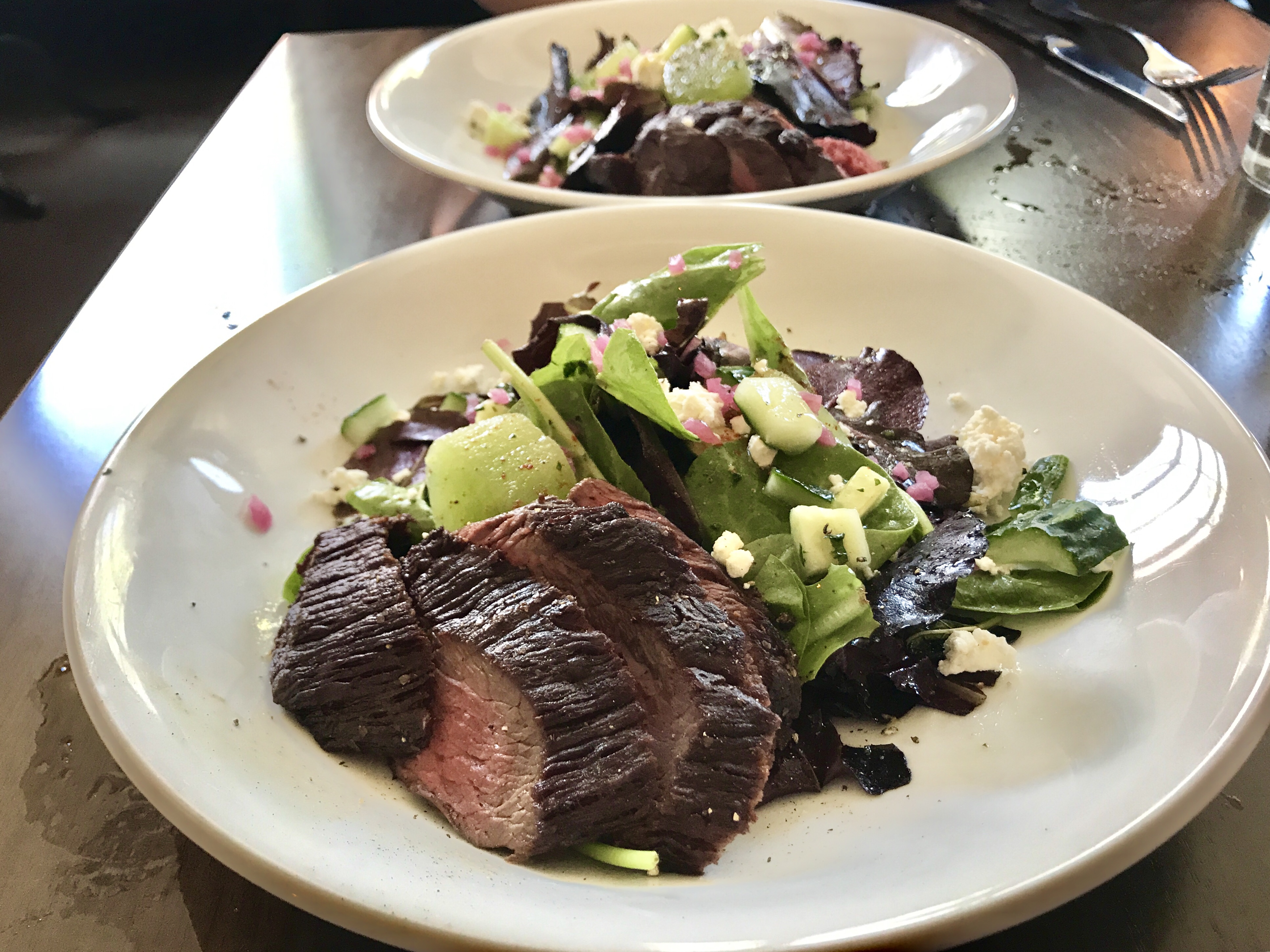 The Mustard and Melon Salad with perfectly cooked Arizona sirloin for lunch from Augstin Kitchen at Mercado San Augustin in Tucson, Arizona