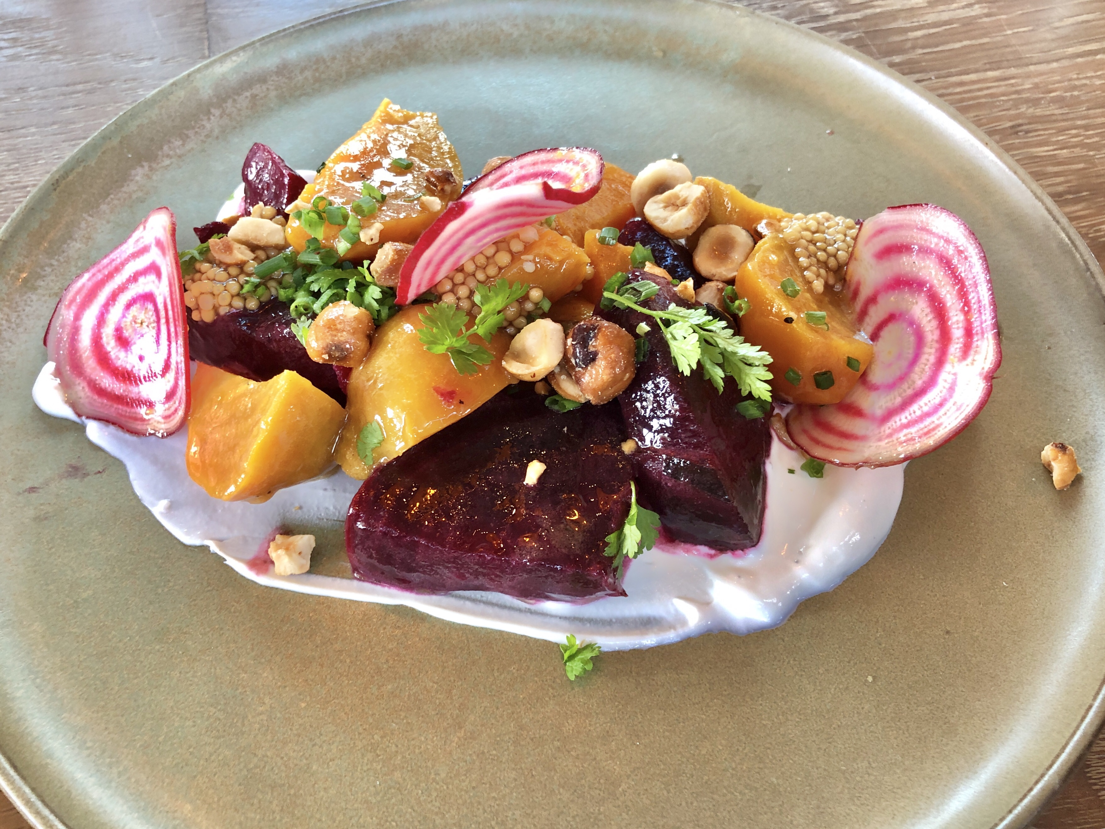 Ember-roasted beets with sheep's milk yogurt and candied hazelnuts at Rye Street Tavern in Port Covington, Baltimore, Maryland