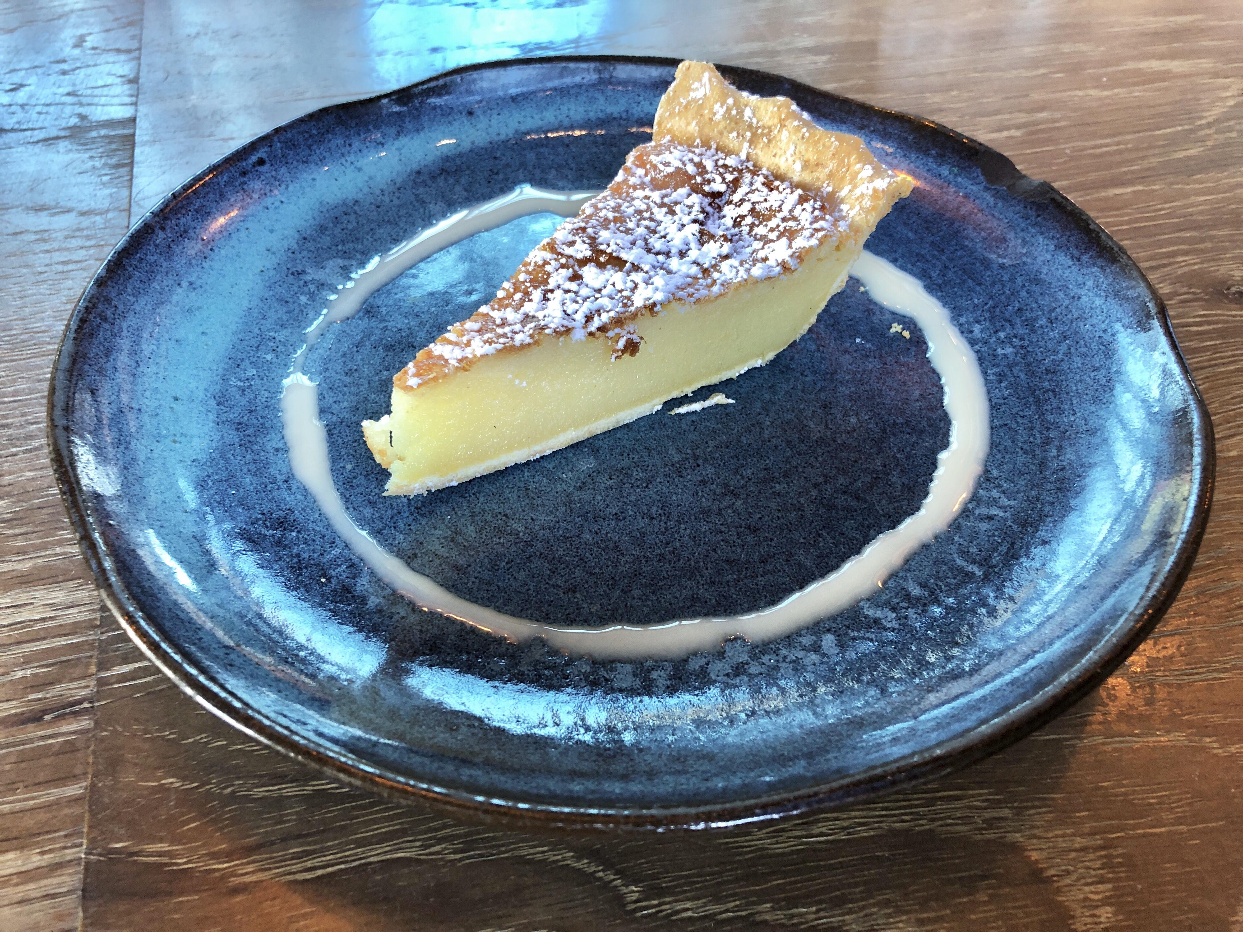 Slice of vanilla buttermilk pie at Rye Street Tavern in Port Covington, Baltimore, Maryland