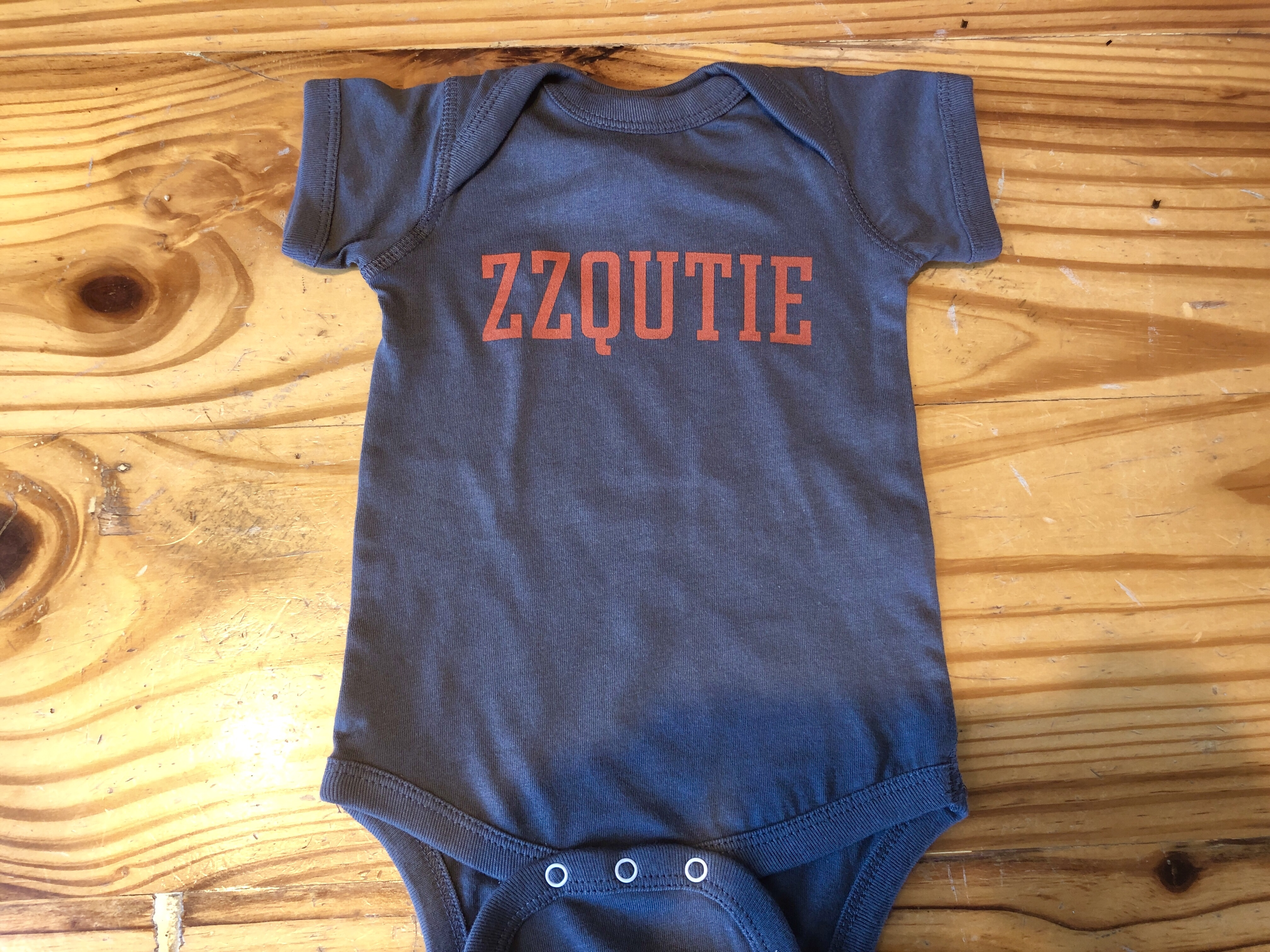 A baby onesie at ZZQ in Richmond, Virginia
